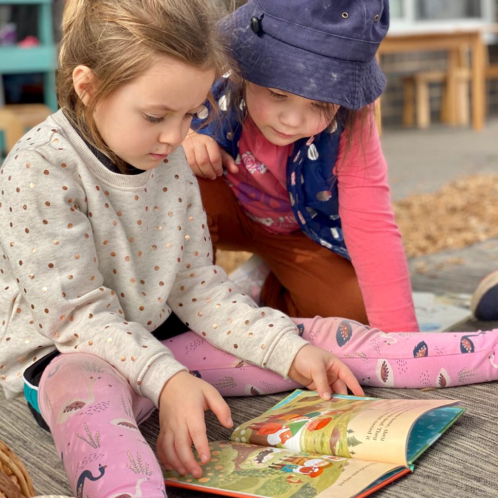 Children reading together at Inspira kids learning centre